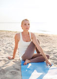 Young woman making yoga exercises outdoors Stock Photos