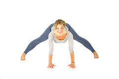 Young woman making a yoga posture Stock Photo