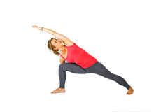Young woman making a yoga posture Royalty Free Stock Photos