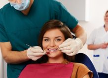 Young woman and male dentist Royalty Free Stock Photos