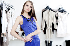 Young woman in mall buying clothes Stock Images