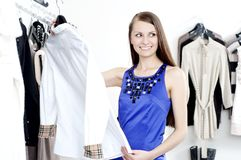Young woman in mall buying clothes royalty free stock photos