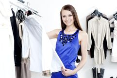 Young woman in mall buying clothes Royalty Free Stock Photography
