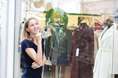 Young woman in mall buying clothes Stock Photos