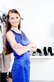 Young woman in mall buying clothes Stock Photo
