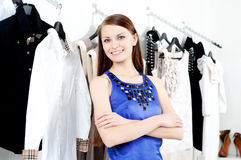 Young woman in mall buying clothes Royalty Free Stock Photo