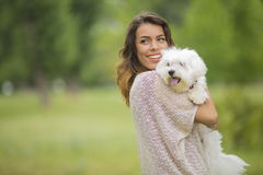 Young woman with a maltese dog. Outside Stock Photo