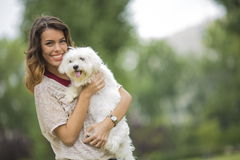 Young woman with a maltese dog. View of the young woman with a maltese dog Royalty Free Stock Photos
