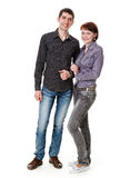 Young woman and man. Young woman and man standing on the floor, the girl holds the hand of a guy, isolated on a white background Stock Photo
