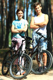 Young woman and man with bicycles Stock Photo