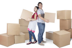 Young woman and man carry box Royalty Free Stock Photography
