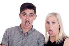 Young woman and man. Young caucasian couple or siblings in studio Stock Images