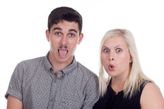 Young woman and man. Young caucasian couple or siblings in studio with funny expressions Royalty Free Stock Image