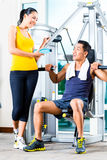 Young woman and man chatting. Young women and men chatting at gym stock photo