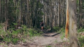 Young woman and man doing trail stock footage