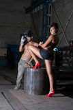 Young woman and man in factory Stock Photography