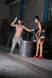 Young woman and man in factory Royalty Free Stock Photos