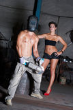 Young woman and man in factory Royalty Free Stock Image