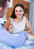 Young woman and man with financial documents in agency Stock Image