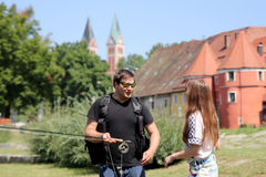 This iare Young woman and man while fishing  on a river in Bavaria Royalty Free Stock Photo