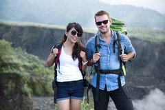 Young woman and man go trekking together, nature background Stock Image