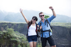 Young woman and man go trekking together, nature background Stock Images