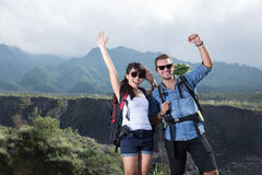 Young woman and man go trekking together, nature background Royalty Free Stock Image