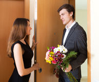 Young woman and man greeting Stock Images