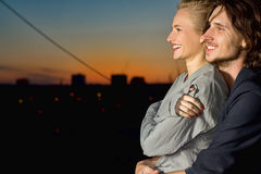 Young woman and man happy smiling. Outdoor Stock Photos