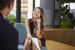 Young woman and man at an informal office meeting, close up Stock Images