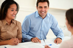 Young woman and man interested in a contract Stock Photos