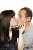 Young woman and man kiss. Studio shoot Royalty Free Stock Photo