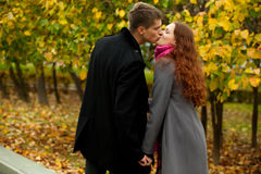 Young woman and man kissing Stock Photo