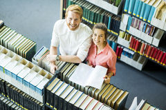 Young woman and man in the library Stock Image