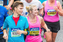 Young woman and man looking happy at something. STOCKHOLM - MAY 31: A young woman and man looking happy at something in ASICS Stockholm Marathon 2014. May 31 Stock Photography
