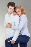 Young woman and man over grey Royalty Free Stock Photo