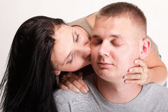 The young woman and the man in passionate embraces Royalty Free Stock Image