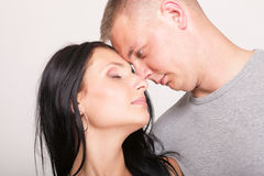 The young woman and the man in passionate embraces Stock Image