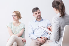 Young woman and man on psychotherapy Stock Photos
