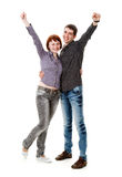 Young woman and man, rejoice. Young woman and man standing on the floor, and rejoice, isolated on a white background Royalty Free Stock Photo
