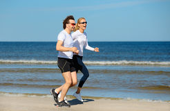 Young woman and man running Royalty Free Stock Images