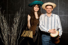 Young woman and man in sombrero and with drum Royalty Free Stock Photo