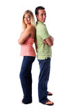 Young Woman and Man Standing. Portrait of young woman and man standing back to back Royalty Free Stock Photography
