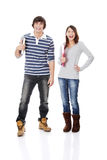 Young woman and man standing with books Royalty Free Stock Photography