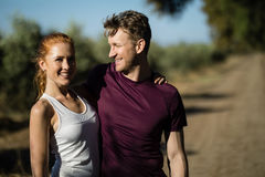 Young woman with man standing at farm on sunny day Royalty Free Stock Photography