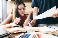 Young woman and man studying for a test or an exam. Study group stock photo