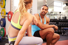 Young woman and man talking at a gym Royalty Free Stock Image
