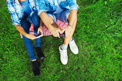 Young woman and man on their cell phones Stock Images
