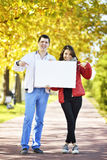 Young woman and man walking stock images