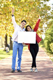 Young woman and man walking Stock Photography